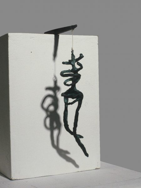 "Crucifix, 1992. Bronze & patina, iron & thread. 220 x 50 x 140mm (8.5 x 2 x 5.5"")"