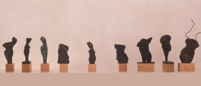 "Fragments. Bronze figures, patina and wire, 1992.   90 -200mms (3.5 -8"") approx. on boxwood plinths"