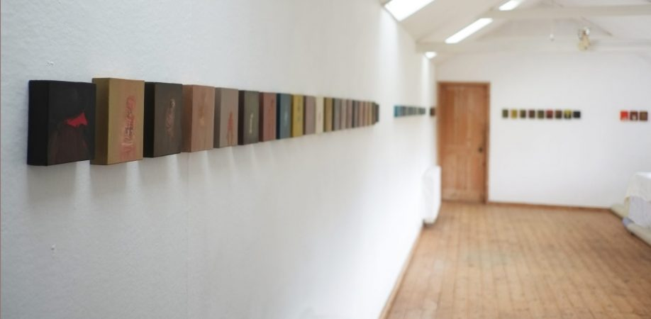 In foreground: Into the Cloisters, oil on 21 canvas blocks. A single sequence out of 40 that form Into the Holloway, 2017. Further sequences tracking the walls can be seen beyond.